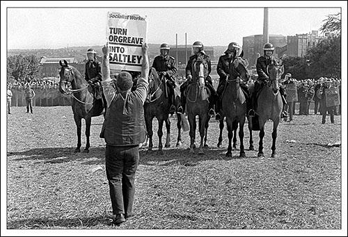 "Greetings card of Orgreave Coking Plant, Near Sheffield, 18th June 1984 showing a picket holding up a placard saying ""Turn Orgreave into Saltely""."