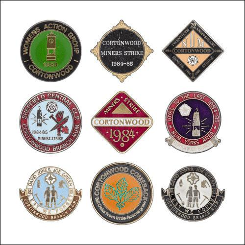 Greetings card of a collection of enamel badges from Cotonwood Colliery.