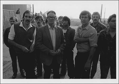 Greetings card of pickets at the front gates of easington Colliery on 20th August 1985 as the police try to get the first working miner into the pit.