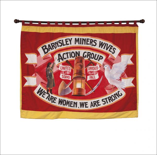 The front page of the greetings card of the banner of the Barnsley Miners Wives Action Group  showing the front of the banner.