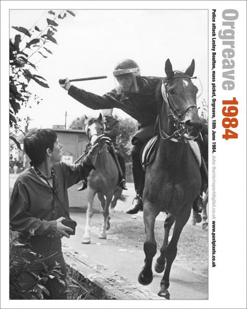 The poster of Lesley Boulton at the Orgreave Coking Plant about to be hit on the head with a truncheon by a moving mounted police officer.