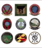 Greetings card of a collection of enamel badges from Northumberland.