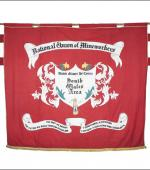 Greetings card of the front of the banner of the South wales Area of the NUM.