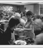 The greetings card of Marilyn Johnson serving lunch during the August school holidays in 1984 at the Colliery Club, Easington Colliery, County Durham.