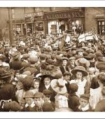 Mary Mcarthur addressing a crowd in a street during the strike