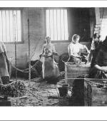 The front of the greetings card of young women chainmakers at work around 1910.