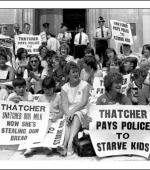 Postcard of women and children demonstrating against £15 being deducted from striking miners' benefit in lieu of strike pay, which was not being paid, outside the  Welsh Office in Cardiff on 30th July 1984